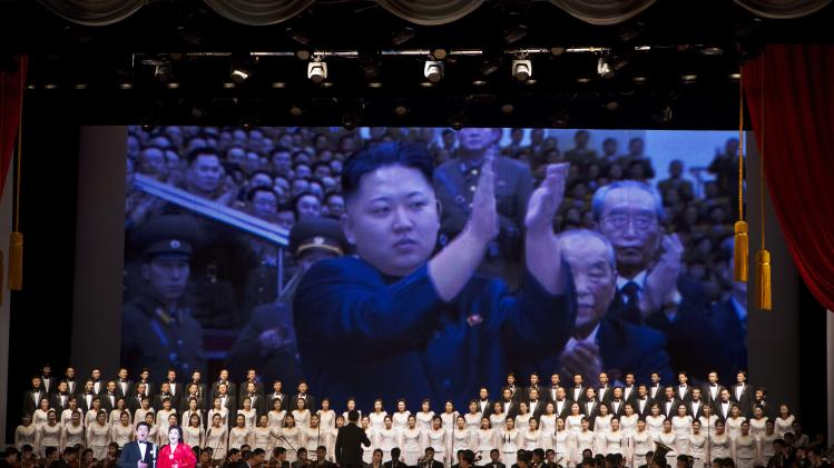In this Feb. 17, 2013 photo, an image of North Korean leader Kim Jong Un is projected on a screen behind an orchestra and choir during a performance in Pyongyang, North Korea. (AP Photo/David Guttenfelder)