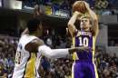 Los Angeles Lakers' Nash shoots the basketball over Pacers' Mahinmi during the first half of an NBA basketball game in Indianapolis
