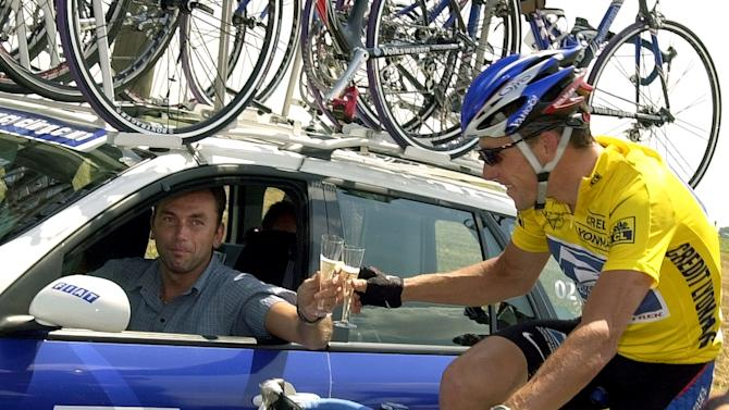 """FILE - In this July 28, 2002, file photo, overall leader Lance Armstrong of Austin, Texas, toast team director Johan Bruyneel with a glass of champagne during the final stage of the Tour de France cycling race between Melun and Paris, France. The U.S. Anti-Doping Agency is bringing doping charges against the seven-time Tour de France winner, questioning how he achieved those famous cycling victories.  Armstrong, who retired from cycling last year, could face a lifetime ban from the sport if he is found to have used performance-enhancing drugs. He maintained his innocence, saying: """"I have never doped.""""  (AP Photo/Peter Dejong, File)"""