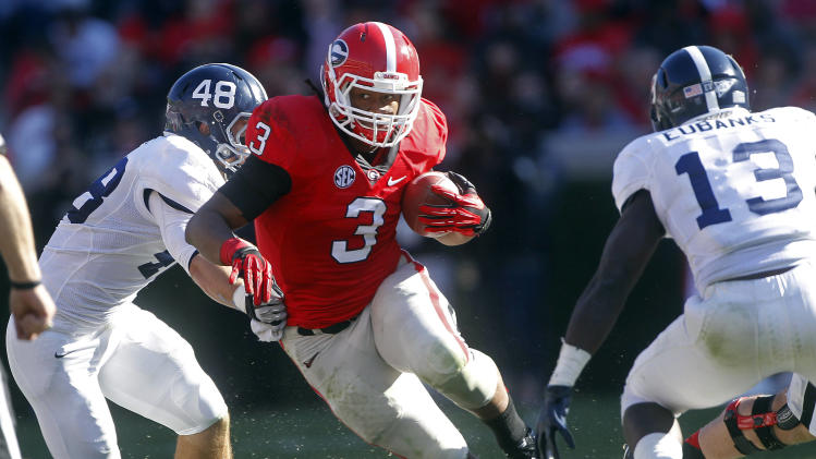 Georgia running back Todd Gurley (3) runs against Georgia Southern linebackers Patrick Flowe (48) and Darius Eubanks (13)in the first half of an NCAA college football game Saturday, Nov. 17, 2012 in Athens, Ga. Georgia won 45-14. (AP Photo/John Bazemore)