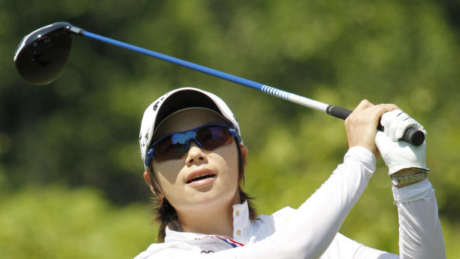 Eun-Hee Ji, of South Korea, hits a tee shot on the third hole during the Wegmans LPGA Championship at Locust Hill Country Club in Pittsford, N.Y., Sunday, June 10, 2012. (AP Photo/Derek Gee)