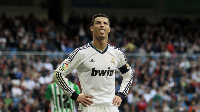 Real Madrid's Cristiano Ronaldo from Portugal reacts during a Spanish La Liga soccer match against Betis at the Santiago Bernabeu stadium in Madrid, Spain, Saturday, April 20, 2013. (AP Photo/Andres Kudacki)