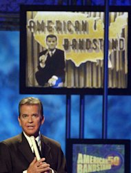 "FILE - In this April 20, 2002 file photo, Dick Clark, host of the American Bandstand television show, introduces entertainer Michael Jackson on stage during taping of the show's 50th anniversary special in Pasadena, Calif. Clark, the television host who helped bring rock `n' roll into the mainstream on ""American Bandstand,"" died Wednesday, April 18, 2012 of a heart attack. He was 82. (AP Photo/Kevork Djansezian, File)"