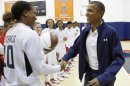 Obama greets Catchings and other members of the U.S. Olympic women's basketball team after their exhibition game against Brazil in Washington