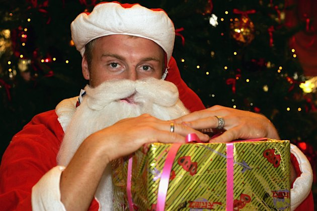 KARACH!, PAKISTAN - DECEMBER 14:  Andrew Flintoff dresses as Santa Claus at the team's hotel during the England cricket winter tour on December 14, 2005 in Karachi, Pakistan.  (Photo by Julian Herbert
