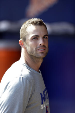 New York Mets third baseman David Wright stands in the dugout before an exhibition spring training baseball game against the Atlanta Braves Sunday, March 16, 2013, in Port St. Lucie, Fla. Wright recently strained a muscle in his rib cage while working out before a World Baseball Classic game, which could cause him to miss opening day with the injury. (AP Photo/Jeff Roberson)
