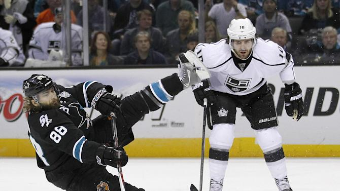 San Jose Sharks defenseman Brent Burns (88) is tripped by Los Angeles Kings center Mike Richards (10) during the first period in Game 6 of their second-round NHL hockey Stanley Cup playoff series in San Jose, Calif., Sunday, May 26, 2013. (AP Photo/Tony Avelar)
