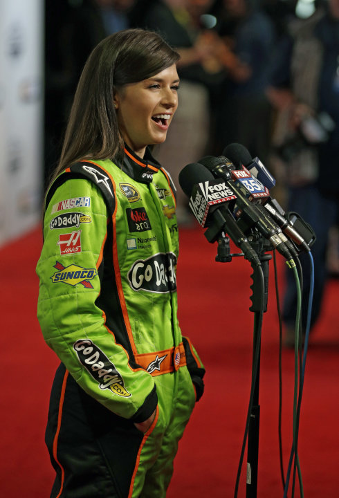 Auto racing driver Danica Patrick speaks with reporters during NASCAR media day at Daytona International Speedway, Thursday, Feb. 14, 2013, in Daytona Beach, Fla. (AP Photo/John Raoux)