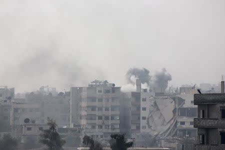 Smoke rises after what activists said was an airstrike by forces loyal to Syria's President Bashar al-Assad in eastern Al-Ghouta, near Damascus
