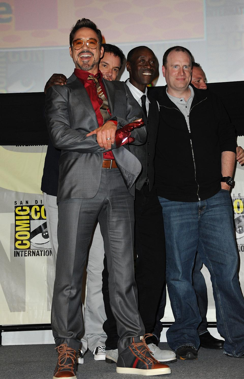"Robert Downey Jr., Shane Black, Don Cheadle and Kevin Feige pose at the ""Iron Man 3"" panel 2012 Comic Con on Saturday, July 14, 2012 in San Diego, Calif. (Photo by Jordan Strauss/Invision/AP)"