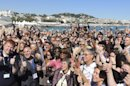 Wife of Roger Ebert, Chaz Ebert, center second row, joins others in giving the two thumbs up at the American Pavilion at the 66th international film festival, in Cannes, southern France, Thursday, May 23, 2013. Film critics and festival-goers congregated on the Cannes beach Thursday to raise their thumbs to the late critic Roger Ebert. Before his death in April, Ebert was a frequent presence at Cannes. In 2009, the festival named a conference center at the American Pavilion after the Pulitzer Prize-winning critic. (AP Photo/Nekesa Mumbi Moody)