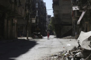 A girl stands in a damaged street in Ain Tarma, in Eastern Ghouta, a suburb of Damascus