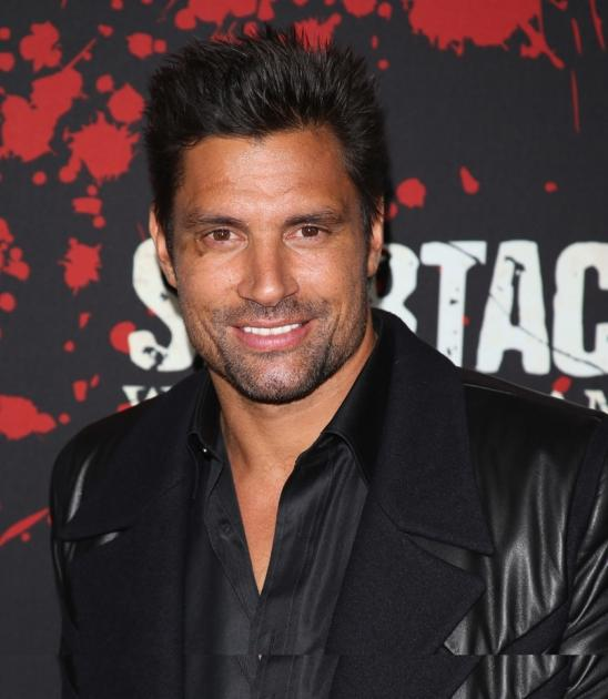 Manu Bennett arrives at the 'Spartacus: War Of The Damned' Los Angeles Premiere at Regal Cinemas L.A. LIVE Stadium 14 on January 22, 2013  -- Getty Images