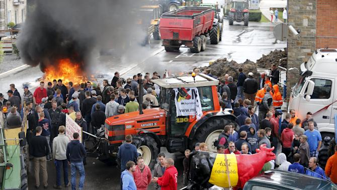 Belgian dairy farmers block the access to the milk processing factory Corman during a protest against low milk prices in Bethane
