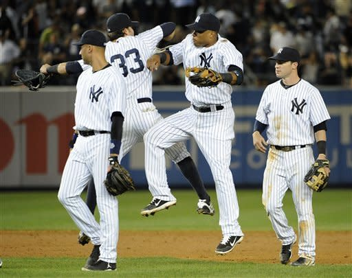 Hughes, Swisher lead Yankees past Blue Jays 2-1