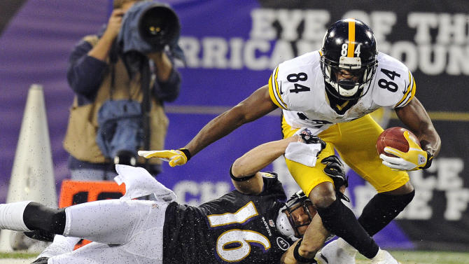 Baltimore Ravens' David Reed (16) pulls Pittsburgh Steelers wide receiver Antonio Brown to the ground during the first half of an NFL football game in Baltimore, Sunday, Dec. 2, 2012. (AP Photo/Nick Wass)