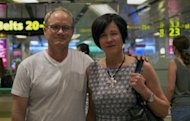 Rick (L) and Mary Todd (R), the parents of an US scientist Shane Todd arrive at Changi International airport in Singapore on May 6, 2013. Singapore will launch a public inquiry Monday into the death of a US researcher whose family believes he was murdered because of a high-tech project for a Chinese firm that has been suspected of espionage.