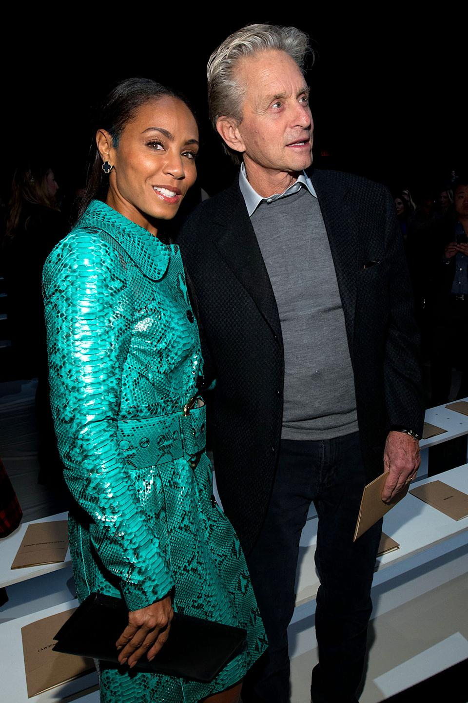 Jada Pinkett Smith, left, and Michael Douglas attend the Fall 2013 Michael Kors Runway Show, on Wednesday, Feb. 13, 2013 in New York. (Photo by Dario Cantatore/Invision/AP)