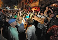 Revelers celebrate in front of the Stonewall Inn in Manhattan's west village following the passing of the same sex marriage bill by a vote of 33 to 29, Friday, June 24, 2011, in New York. Same-sex marriage is now legal in New York after Gov. Andrew Cuomo signed a bill that was narrowly passed by state lawmakers Friday, handing activists a breakthrough victory in the state where the gay rights movement was born. The gay rights movement is considered to have started with the Stonewall riots in New York City's Greenwich Village in 1969. (AP Photo/Louis Lanzano)