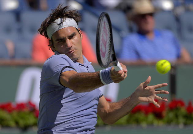 Roger Federer, of Switzerland, hits to Dmitry Tursunov, of Russia, during a third round match at the BNP Paribas Open tennis tournament, Monday, March 10, 2014 in Indian Wells, Calif. (AP Photo/Mark J