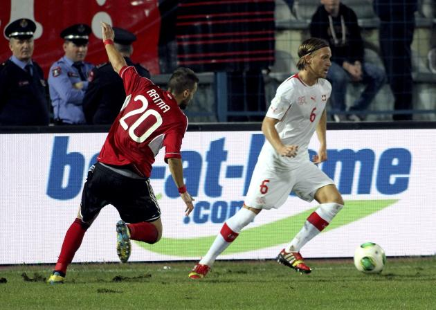 Switzerland's Michael Lank fights for the ball with Albania's Valdet Rama during their 2014 World Cup qualifying soccer match in Tirana