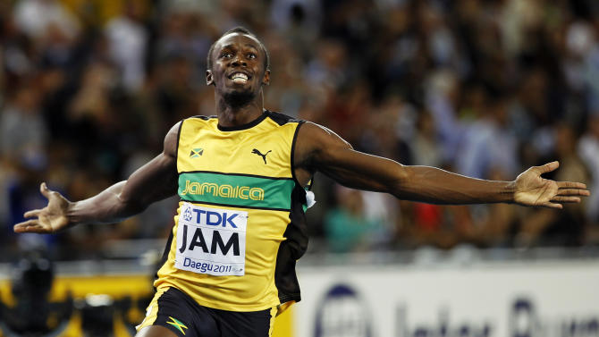 FILE - This Sept. 4, 2011 file photo shows Jamaica's Usain Bolt celebrating after winning the men's 4x100 relay final,  and setting a world record,  at the World Athletics Championships in Daegu, South Korea. Any talk of the Olympics has to start with the flashy Jamaican sprinter. His performance in Beijing four years ago was magical.  (AP Photo/Lee Jin-man, FIle)
