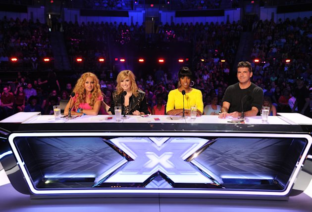 """The X Factor"" Season 3 judges Paulina Rubio, Demi Lovato, Kelly Rowland and Simon Cowell."