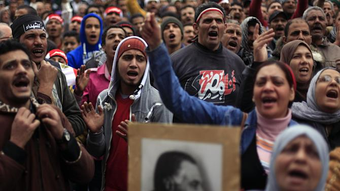 Egyptian protesters chant anti- government slogans during a rally in Tahrir Square, Cairo, Egypt, Friday, Feb. 1, 2013. Thousands of Egyptians marched across the country, chanting against the rule of the Islamist President Mohammed Morsi, in a fresh wave of protests Friday, even as cracks appeared in the ranks of the opposition after its political leaders met for the first time with the rival Muslim Brotherhood.(AP Photo/Khalil Hamra)