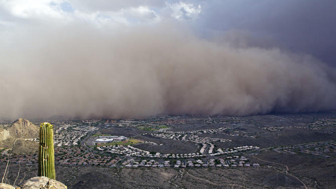 A dust storm rolls into the Phoenix area Monday evening,  July 18, 2011. The dust wall was about 3,000 feet (900 meters) high and created winds of 25 to 30 mph (40 to 48 kph), with gusts of up to 40 mph (64 kph), said Austin Jamison, a meteorologist with the National Weather Service. (AP Photo/The Arizona Republic, Nick Oza)  MARICOPA COUNTY OUT; MAGS OUT; NO SALES