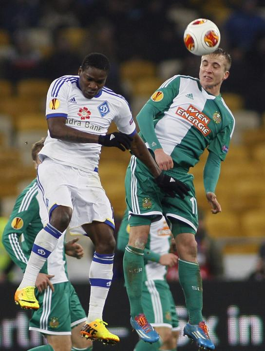 Dynamo Kiev's Ideye fights for the ball with Rapid Vienna's Dibon during their Europa League soccer match in Kiev