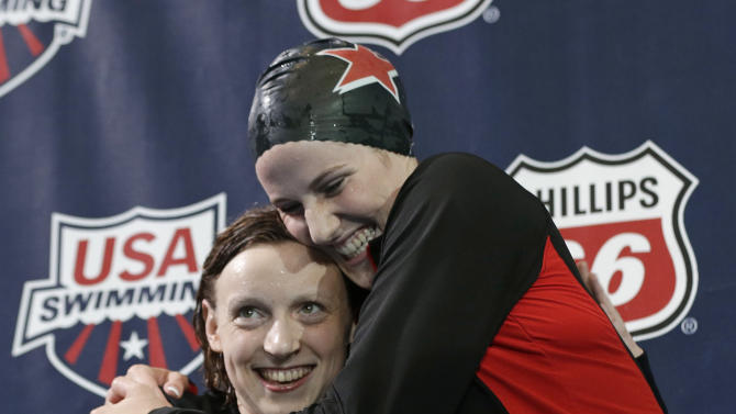 Missy Franklin, right, hugs Katie Ledecky on the podium after Franklin won the women's 200-meter freestyle during the U.S. National Championships swimming meet Wednesday, June 26, 2013, in Indianapolis. Franklin won in 1 minute, 55.56 seconds. (AP Photo/Darron Cummings)