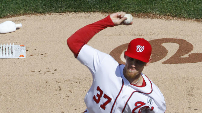 Washington Nationals starting pitcher Stephen Strasburg (37) throws in the first inning of the opening day baseball game against the Miami Marlins in Washington, on Monday, April 1, 2013.  (AP Photo/J. David Ake)