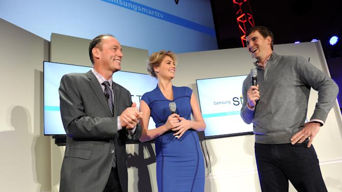 IMAGE DISTRIBUTED FOR CLIENT NAME - Tim Baxter, left, President, Samsung Electronics America, model Kate Upton and football quarterback Eli Manning showcase the 2013 line of Smart TVs, Wednesday, March 20, 2013, in New York.  Samsung's new line allows the viewer to discover more of the TV they love with a smarter and more personalized experience.  (Photo by Diane Bondareff/Invision for Samsung/AP Images)