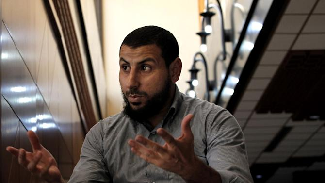 "Youssef Jihani, senior member of Ansar al-Shariah Brigades, speaks to the Associated Press during an interview, in Benghazi, Libya, Sept. 18, 2012. Ansar al-Shariah is among the most powerful of the many, heavily armed militias that the government relies on to keep security in Benghazi. Jihani, denied the group took part in the attack. ""We never approve of killing civilians, especially those who helped us,"" he said the day after the attack. (AP Photo/Mohammad Hannon)"