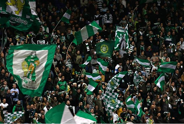 Sporting supporters cheer in the stands during their Portuguese league soccer match against  Belenenses Saturday, Dec. 14 2013, at Sporting's Alvalade stadium in Lisbon. Sporting defeated Belenens