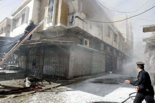 &lt;p&gt;Iraqi firemen extinguish a fire following a car bomb that exploded in the northern city of Kirkuk on June 20. A car bomb south of Baghdad killed eight people and wounded 32 on Monday, while a roadside bomb north of the capital killed four people and wounded seven, security and medical sources said.&lt;/p&gt;