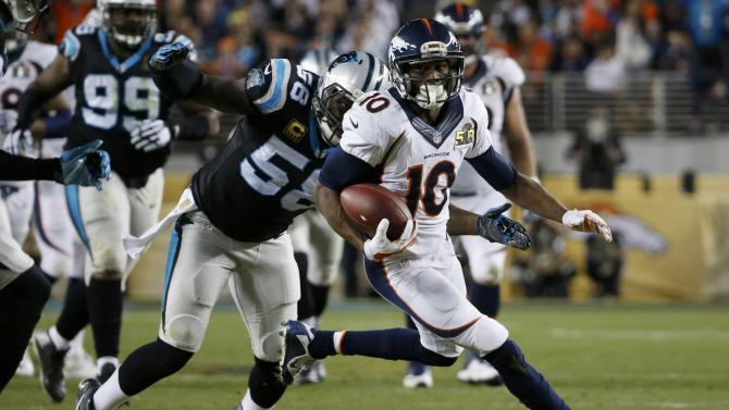 Denver Broncos' Sanders runs with the ball past Carolina Panthers' Davis after a reception during the NFL's Super Bowl 50 football game in Santa Clara