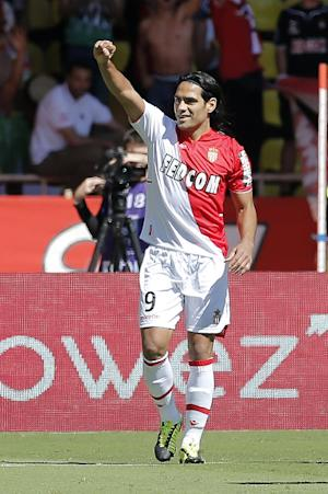 Monaco returns to top of French league