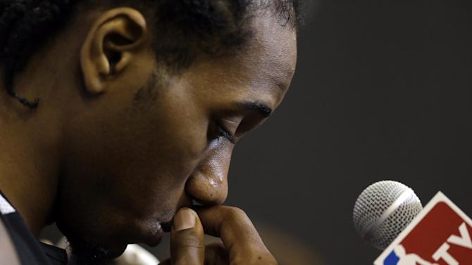San Antonio Spurs forward Kawhi Leonard listens to a question during practice on Saturday, June 7, 2014, in San Antonio. The team plays Game 2 of the NBA Finals against the Miami Heat on Sunday