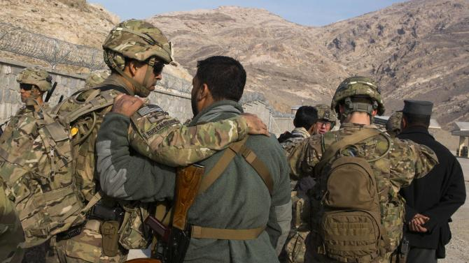 U.S. soldiers from the 3rd Cavalry Regiment greet their Afghan police counterparts during an advising mission to an Afghan police station constructed by ISAF near Jalalabad