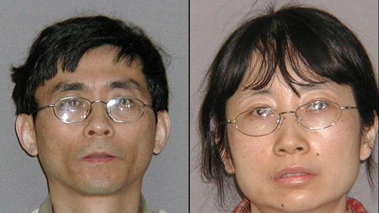FILE - This combination of July 22, 2010 file photos provided by the U.S. Marshals Service shows Yu Qin, left, and his wife, Shanshan Du, who who were convicted of stealing hybrid technology from General Motors. Shanshan Du, a former GM engineer, was sentenced to a year and a day in prison Wednesday, May 1, 2013, in Detroit. Her husband, Yu Qin (chin), was ordered to spend three years behind bars. (AP Photo/U.S. Marshals Service, File)