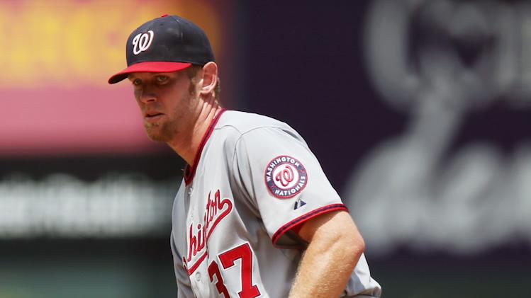 Washington Nationals starting pitcher Stephen Strasburg reacts after giving up an RBI-single to Colorado Rockies' Michael McKenry in the first inning of a baseball game in Denver on Wednesday, July 23, 2014. (AP Photo)