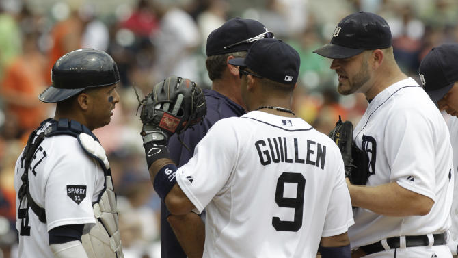 Detroit Tigers starting pitcher Brad Penny, right, argues with catcher Victor Martinez, left, as pitching coach Jeff Jones visits the mound during the fourth inning of a baseball game against the Los Angeles Angels in Detroit, Thursday, July 28, 2011. Looking on is Carlos Guillen. (AP Photo/Paul Sancya)