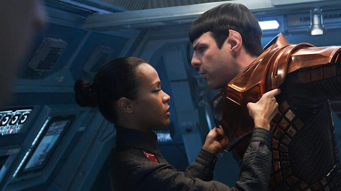 """This undated publicity film image released by Paramount Pictures shows, Zoe Saldana, left, as Uhura and Zachary Quinto as Spock in a scene in the movie, """"Star Trek Into Darkness,"""" from Paramount Pictures and Skydance Productions. (AP Photo/Paramount Pictures, Zade Rosenthal)"""