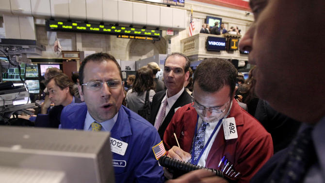 Specialist Michael Pistillo, left, works at his post on the floor of the New York Stock Exchange Monday, Aug. 1, 2011. (AP Photo/Richard Drew)