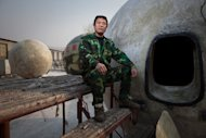 This photo from December 11, 2012 shows Liu Qiyuan proudly showing off the pods that he created, in the village of Qiantun, Hebei province, south of Beijing. Liu first conceived of spherical houses to withstand earthquakes, which occur frequently in China, but switched his focus to survival technology after the 2004 Indian Ocean tsunami, which claimed nearly a quarter of a million lives