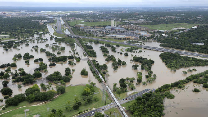 The Olmos Basin Municipal Golf Course and Basse Road in San Antonio are underwater Saturday May 25, 2013 as a result of heavy rains in San Antonio. Saturday was the second wettest day in San Antonio history with the National Weather Service recording 9.83 inches of rain by 10:30 a.m. (AP Photo/San Antonio Express-News, Billy Calzada)   RUMBO DE SAN ANTONIO OUT; NO SALES   MBO