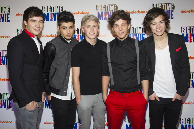 FILE - In this March 8, 2012 file photo, members of the band One Direction, from left, Liam Payne, Zayn Malik, Niall Horan, Louis Tomlinson and Harry Styles attend the premiere of the Nickelodeon TV movie &quot;Big Time Movie&quot; in New York. One Direction, who came in third place on the UK&#39;s &quot;X Factor&quot; in 2010, is one of many boy bands who have recently emerged on the music scene since *NSYNC and Backstreet Boys dominated pop music in the 1990s. (AP Photo/Charles Sykes, file)
