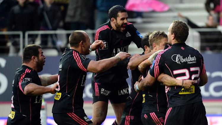 Stade Francais' players celebrate after Jules Plisson scored a try during their French Top 14 rugby union match against Toulon, at the Jean Bouin stadium in Paris, on November 30, 2013