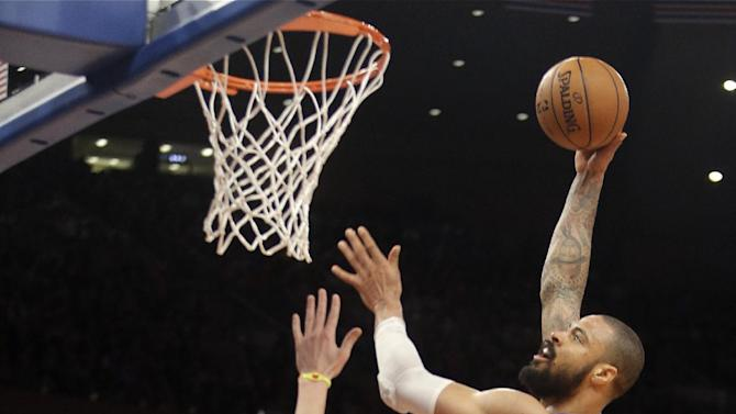 New York Knicks' Tyson Chandler, top, shoots over Golden State Warriors' Klay Thompson (11) during the first half of an NBA basketball game on Wednesday, Feb. 27, 2013, in New York. (AP Photo/Frank Franklin II)